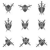 Iconos del escudo y de la espada Fotos de archivo