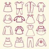 Iconos del esquema de la colección de la ropa del bebé y de los niños Imagen de archivo libre de regalías