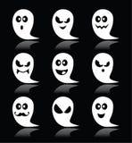 Iconos del fantasma de Halloween fijados en fondo negro Fotos de archivo libres de regalías