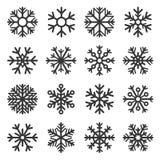 Iconos del invierno del copo de nieve fijados en el fondo blanco Vector stock de ilustración