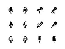 Iconos del micrófono en el fondo blanco. Fotos de archivo
