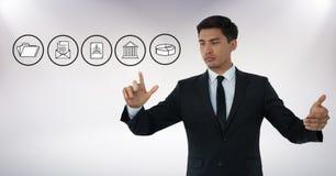 Iconos del negocio y aire conmovedor del hombre de negocios con gestos de mano delante del fondo blanco Fotos de archivo libres de regalías