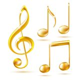 Iconos del oro de una clave de sol y de las notas de la música. Fotos de archivo libres de regalías