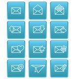 Iconos del sobre para el correo electrónico en cuadrados azules Fotografía de archivo
