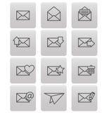 Iconos del sobre para el correo electrónico en cuadrados grises Imagen de archivo libre de regalías