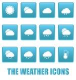 Iconos del tiempo en cuadrados azules Fotografía de archivo libre de regalías