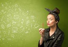 Iconos dibujados mano que soplan y símbolos de la muchacha linda medios Fotos de archivo