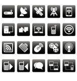 Iconos inalámbricos blancos en casillas negras Imágenes de archivo libres de regalías