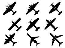 Iconos negros de la silueta de los aviones Foto de archivo