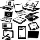 Iconos negros del ordenador portátil y de la tableta Fotografía de archivo libre de regalías