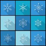 Iconos planos del copo de nieve con la sombra larga Imagen de archivo libre de regalías