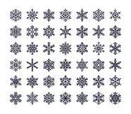Iconos planos del copo de nieve fijados Colección de copos de nieve geométricos lindos, nevadas estilizadas Elemento del diseño p stock de ilustración