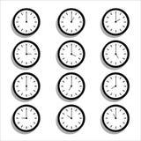 Iconos planos del reloj del diseño Fotos de archivo