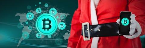 iconos y la Navidad santa del bitcoin que sostiene el teléfono Fotografía de archivo