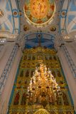 The iconostasis in the cathedral. ISTRA, RUSSIA - JANUARY 3, 2017: The altar and the iconostasis of the Voskresensky New-Jerusalem Stavropegial male monastery Royalty Free Stock Image