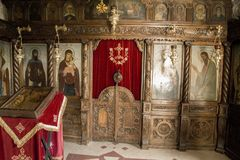 An iconostasis is in a cave. In one of caves of rocky monastery of St. Divitar Basarbovski is iconostasis. Different old icons and other church utensil are here Stock Photo