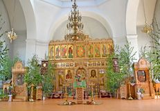 Iconostasis and church furniture of the temple of the Iverian Th eotokos on the Trinity Sunday. Rybinsk, Yaroslavl region. Iconostasis and church furniture of royalty free stock photos