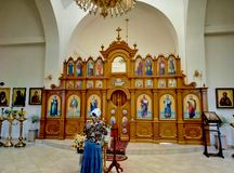 Iconostasis in a rural church. The iconostasis in the village church, on it icons with the faces of the saints. Icons painted artists. the priest has not yet royalty free stock photo