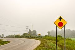 Icons for Arrows and a Stop Sign Ahead. Signs on a sharp curve include arrows pointing in the direction of the curve and a warning of a stop sign ahead royalty free stock photos