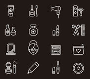Icons describing cosmetics and beauty. White outline illustrations in form of icons describing items relating to cosmetics and beauty, black background Royalty Free Stock Image