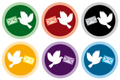Icons of doves with letters Stock Images
