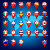 Icons with flags on the world map Stock Photos