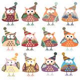 Icons in the form of colorful owls in winter hats Royalty Free Stock Image