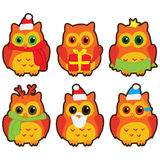 Icons in the form of colorful owls in winter hats Royalty Free Stock Photos