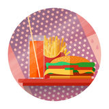 Icons with fries, burgers, a drink on a tray in a flat style. Fast food concept. Icons with fries, burgers, a drink on a tray in a flat style. Can be used for Stock Images