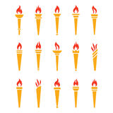 Icons golden torch with flame isolated vector set. The symbol of victory, success or achievement. Silhouettes of various medieval flaming golden torches Stock Photography