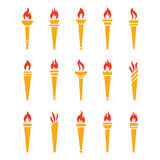 Icons golden torch with flame isolated vector set. The symbol of victory, success or achievement. Silhouettes of various medieval flaming golden torches Royalty Free Stock Image