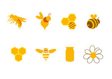 Icons honey and bees. A series of golden bees, honey and honeycombs. Logo for beekeeping. Honey sweet icons. Set of icons. Honey series of icons. Bee set of Royalty Free Stock Images