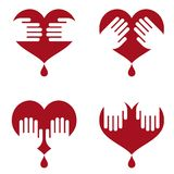 Icons of human heart with hands on it Royalty Free Stock Image