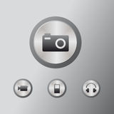 Icons multimedia. Four multimedia icons: fotocamera, videocamera, Mobilephone, Headphone Stock Image