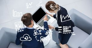 Icons over business people using laptop Royalty Free Stock Images