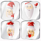 Icons, pictures, pendents about four Santa Claus vector on a gray background. Icons, pictures, pendents about four Santa Claus a vector on a gray background Stock Photography