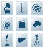 Icons with retro silhouettes. Icons with silhouettes of retro gramophone and reflector and film and camera and microphone and megaphone Royalty Free Stock Images