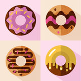 Icons set of donuts. Vector flat style icons set of different types of donuts, top view. Sweet donuts with glaze and decorative sprinkles Royalty Free Stock Photo