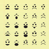Icons of smiley faces. Vector icons of smiley faces on yellow pad stock illustration