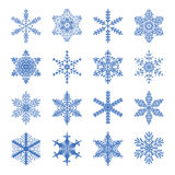 Icons of snowflakes. Blue on white Stock Images