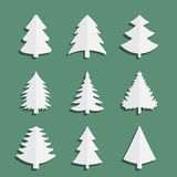 Icons spruce. Christmas fir-tree of an icon. Nine trees on a green background Royalty Free Stock Images