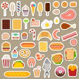 Icons of sweets, fast food, meat and fish. On dark background Royalty Free Stock Photography