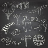 Icons travel on blackboard. Set of hand-drawn travel icons on a black chalkboard Royalty Free Stock Image