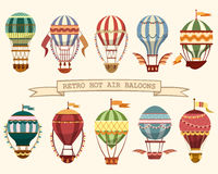 Icons of vintage hot air balloons with flags. Set of different hot air balloons. Flying vintage transport with wings and flags, ballast on basket and striped Royalty Free Stock Photos