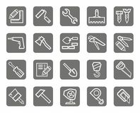 Icons, workers and construction tools, the gray background. Stock Photography