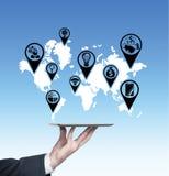 Icons on world map Royalty Free Stock Image