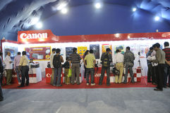 ICT  Fair in Kolkata. KOLKATA- FEBRUARY 20: Consumers flocking inside a CANON booth, during the Information and Communication Technology (ICT) conference and Stock Photos