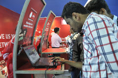 ICT  Fair in Kolkata. KOLKATA- FEBRUARY 20:Curious customers checking the speed of an internet stick during the Information and Communication Technology (ICT) Royalty Free Stock Image