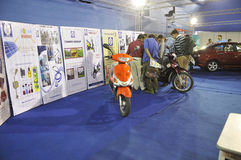 ICT  Fair in Kolkata. KOLKATA- FEBRUARY 20: People flocking around a scooter that runs on solar energy at the Information and Communication Technology (ICT) Stock Image