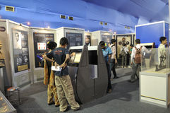 ICT  Fair in Kolkata. KOLKATA- FEBRUARY 20: People gathered inside a science museum booth during the Information and Communication Technology (ICT) conference Stock Photography